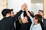 teamwork-business-people-with-joint-hands-in-the-office-100198990